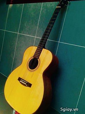 Cần bán cây guitar Gỗ