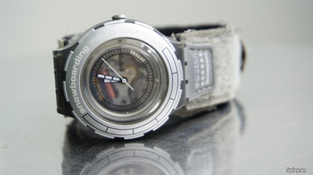 Đồng hồ Swatch Snowpass và Dunlop Phoenix - Swiss