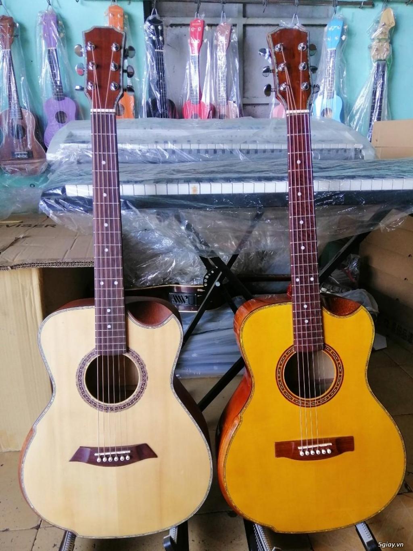 Bán đàn guitar Auscotic giá siêu rẻ tại bình dương - 6